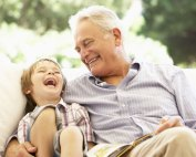 elderly man spending time with grandson