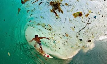 Trash wave surfer in Indonesia