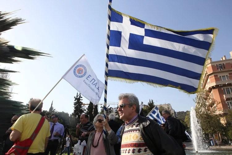 Man holding Greek flag
