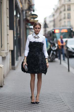 Olivia Palermo bela kosulja uz upadljivu crnu haljinu