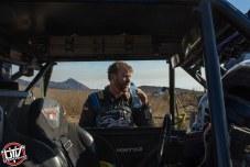 Jagged X Racing driver Matt Parks drinking water at 2018 Baja 1000
