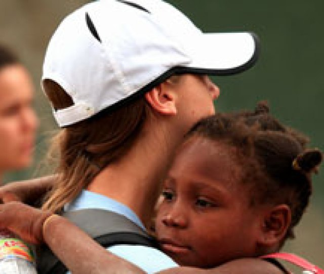 Union University Basketball Player Paige Parker Holds A Haitian Girl During The Teams Recent Mission Trip