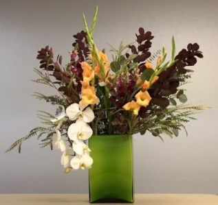 Arrangement with white orchids and dark foliage - Sunday flowers 2018