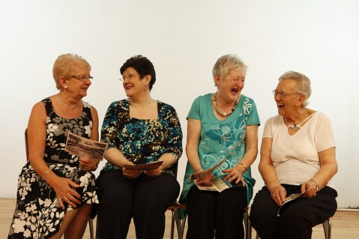 Four senior women talking and laughing