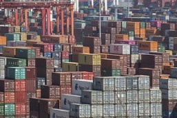 Cranes and stacks of shipping containers