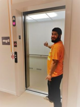 Luis in front of the new UUC elevator - Dec 2019