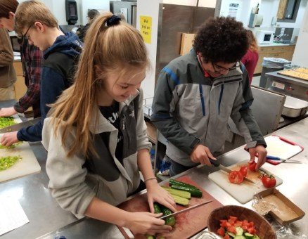 UUC Youth chopping vegetables at Teen Feed, 2019 11 30