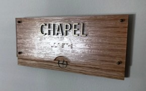 Closeup of new CHAPEL sign with Braille below