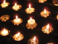 Rows of lighted tealight candles