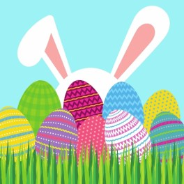 Clip art of bunny ears sticking up behind a collection of brightly colored eggs in the grass