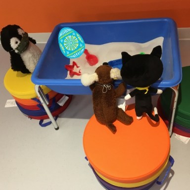 Stuffed animals playing in a sandbox - and there is an Easter egg in the sandbox!