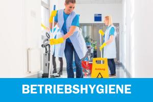 Betriebshygiene - Zwei putzfrauen putzen einen Flur