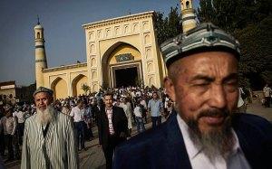 Uyghur men leave the Id Kah Mosque following Eid prayers in old Kashgar, Xinjiang  Photo: Getty