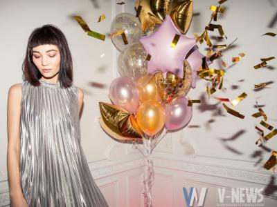 woman wearing pleated silver dress