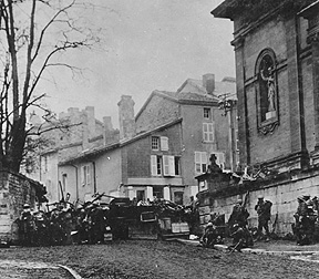 Soldiers of the 353rd Infantry near a church at Stenay, Meuse in France.