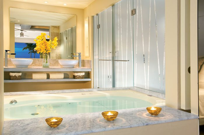 Full bathroom in the Junior Suite features a Jacuzzi for two, double shower and double vanities.