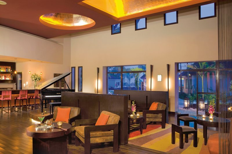 Grab a refreshing cocktail at the lobby bar at Secrets Wild Orchid Montego Bay