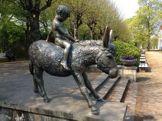 Knabe auf Esel