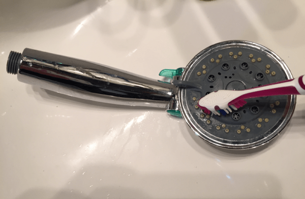 Scrubbing with a toothbrush