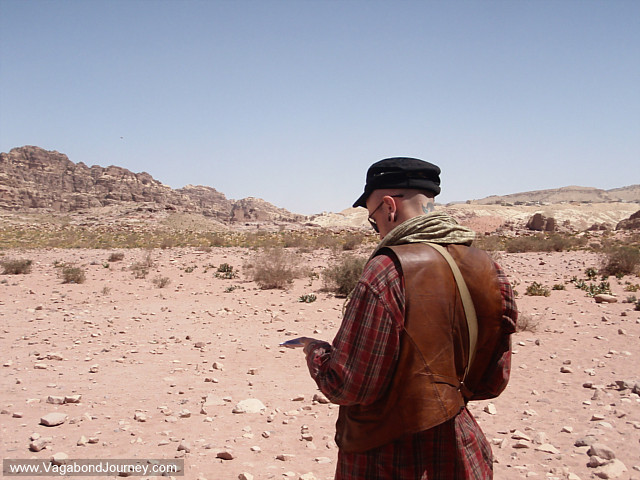 traveler taking notes in petra
