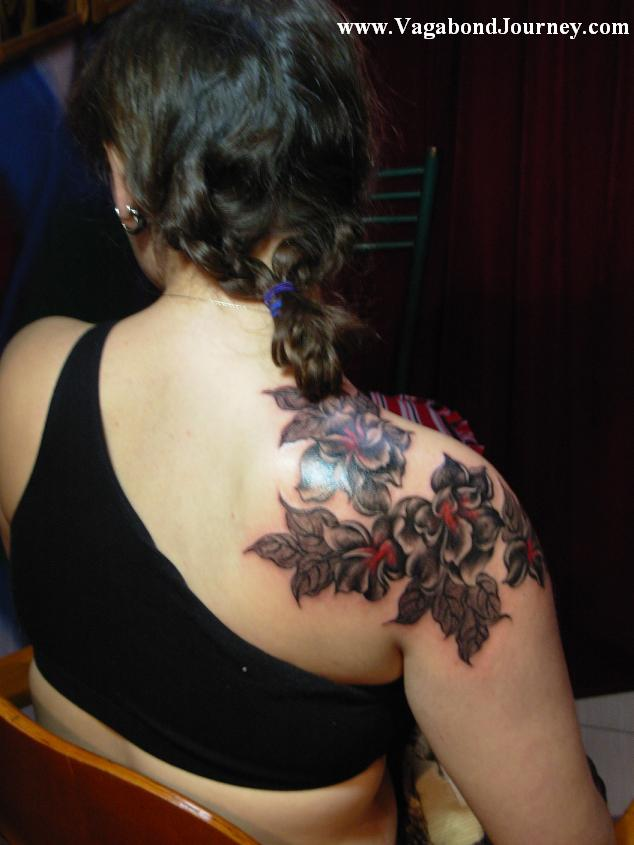 chinese flower tattoo. The above tattoo is of peony flowers that were done