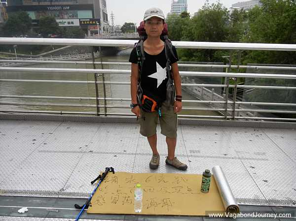 A backpacking beggar in China