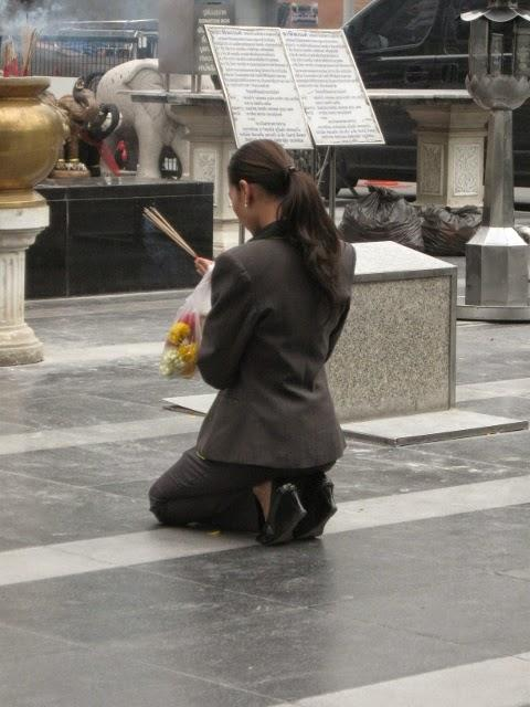 Woman in temple in Thailand