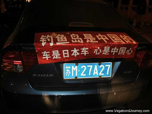 Japanese car in China with patriotic bumper stickers