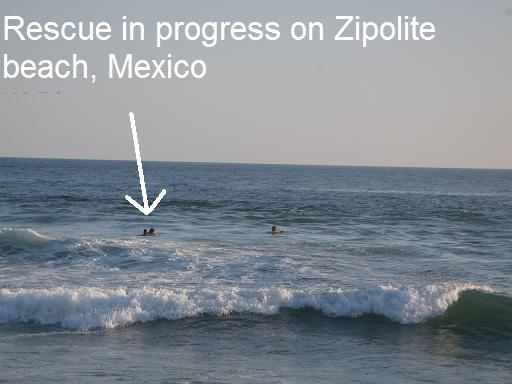Woman being rescued by lifeguards in Zipolite