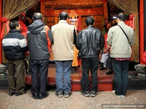 Men worshiping before the alter.