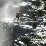 Tourist Rappelling Waterfall