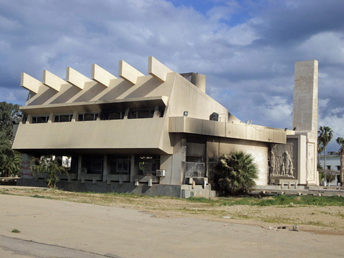 The Green Book center in Benghazi after it was destroyed by protesters By Maher27777 (Own work) [Public domain], via Wikimedia Commons