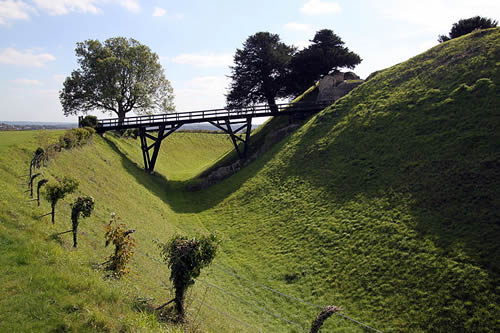 Old Sarum had once been a cathedral city. The people had left, but its Parliamentary seats remained - Old_Sarum_castle_ditch By Nessino (Own work) [CC-BY-SA-3.0 (http://creativecommons.org/licenses/by-sa/3.0)], via Wikimedia Commons