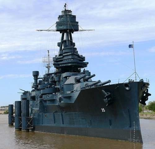 USS Texas in San Jacinto State Park, October 2006. The battleship is painted as it was in 1945 with Measure 21, Navy Blue System Camoflage. The camoflage was intended to make the battleship more difficult to detect from the air By Self-made photo by JacobstJacobst at en.wikipedia [Public domain], from Wikimedia Commons