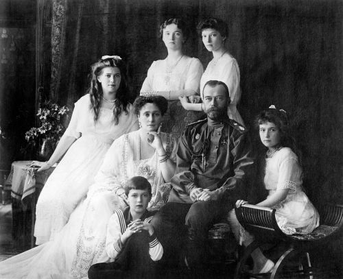 Photo shows members of the Romanovs, the last imperial family of Russia including: seated (left to right) Marie, Queen Alexandra, Czar Nicholas II, Anastasia, Alexei (front), and standing (left to right), Olga and Tatiana.