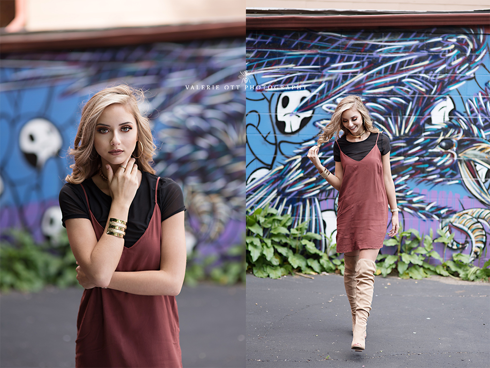senior girl posing near wall art in kalamazoo