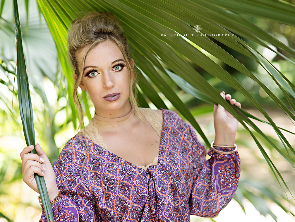 florida senior girl standing near palm trees in clearwater