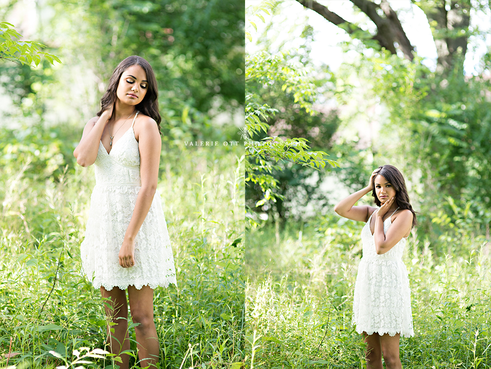 senior girl wearing a white dress standing in a field