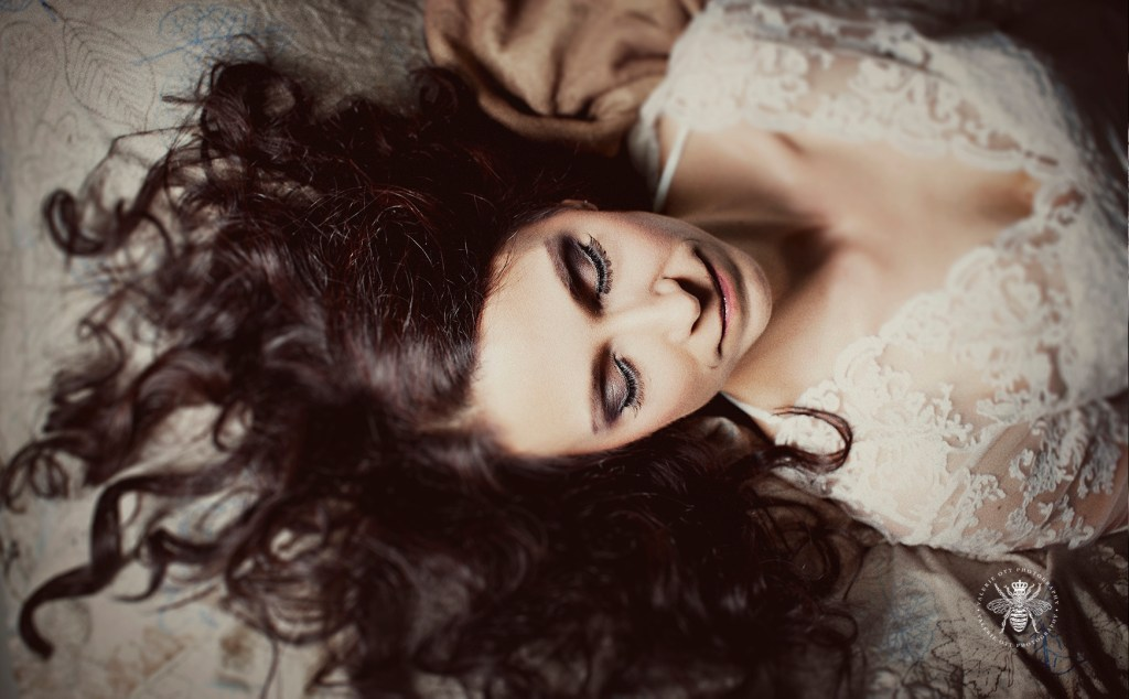 Album cover for Irish worship singer. She poses laying down with her eyes closed, wearing lace, and her dark hair laid out.