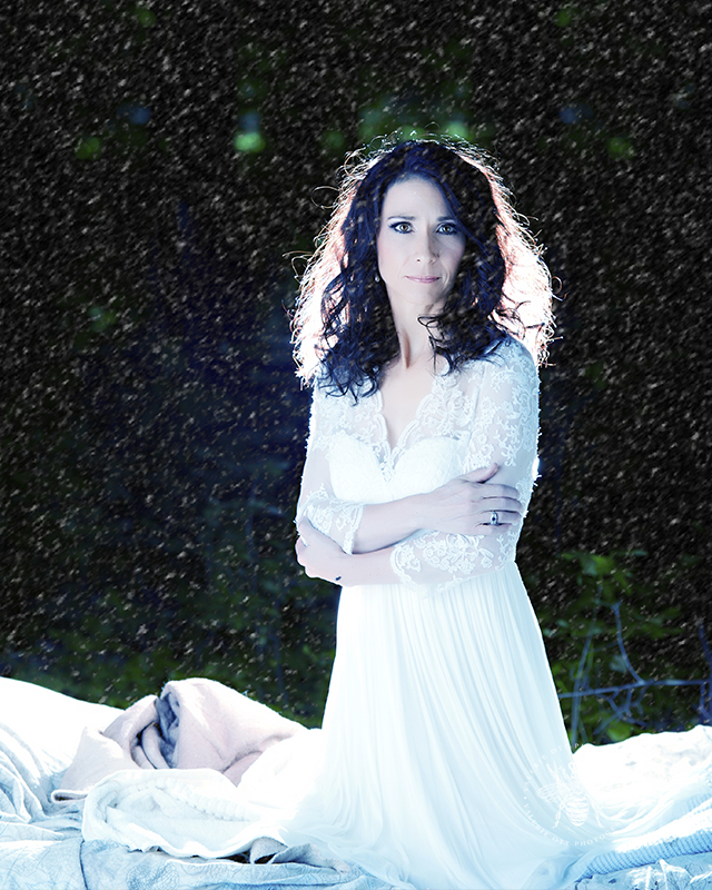 Album cover for Irish singer. She poses wearing lace with snow around her.