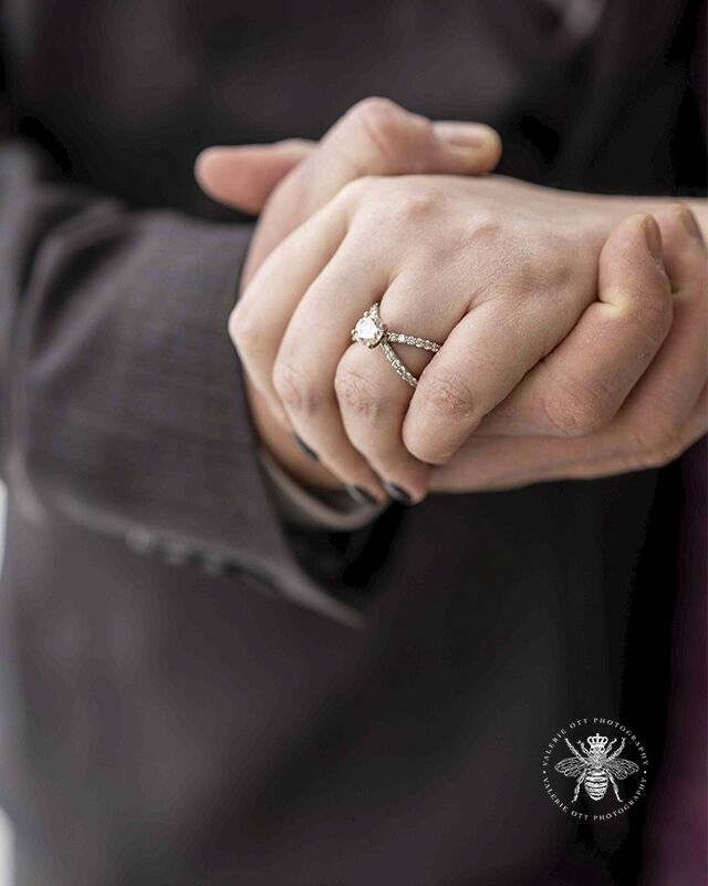 Courthouse wedding in Kalamazoo, Michigan. Close up of couple holding hands and the wedding ring.