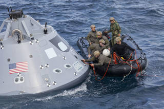 U.S. Navy divers and other personnel in a small Zodiac boat secure a tether line to an attach point on a test version of the Orion crew module during Underway Recovery Test 5 in the Pacific Ocean off the coast of California. NASA's Ground Systems Development and Operations Program and the U.S. Navy are conducting a series of tests using the USS San Diego's well deck, the test module, various watercraft and equipment to prepare for recovery of Orion on its return from deep space missions. The testing will allow the team to demonstrate and evaluate recovery processes, procedures, hardware and personnel in open waters. Orion is the exploration spacecraft designed to carry astronauts to destinations not yet explored by humans, including an asteroid and NASA's Journey to Mars. It will have emergency abort capability, sustain the crew during space travel and provide safe re-entry from deep space return velocities. Orion is scheduled to launch on NASA's Space Launch System in late 2018. For more information, visit http://www.nasa.gov/orion.