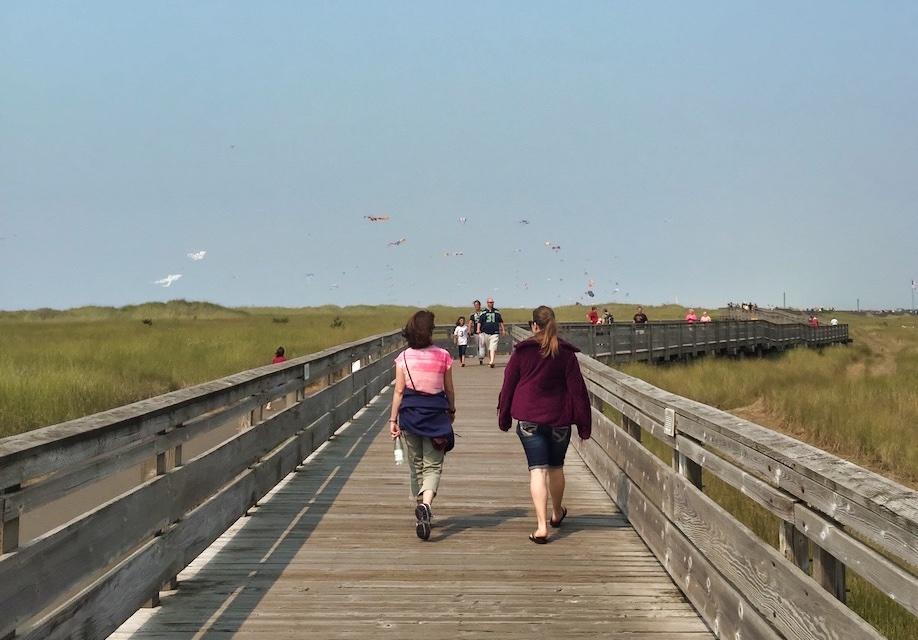 People strolling along the Long Beach Boardwalk