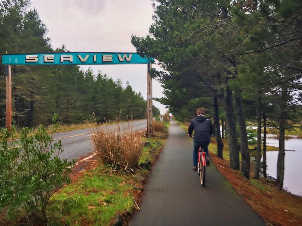 Best Towns in Coastal Washington - Mr. V riding a bike in Seaview