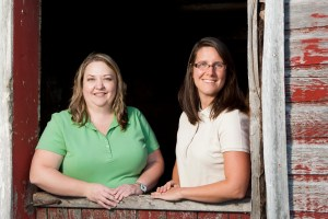 Bridget and Christine both grew up on family farms in Wisconsin. Here they are pictured at Christine's family farm in Polk County.