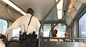 Fare Inspector checking passes on light rail