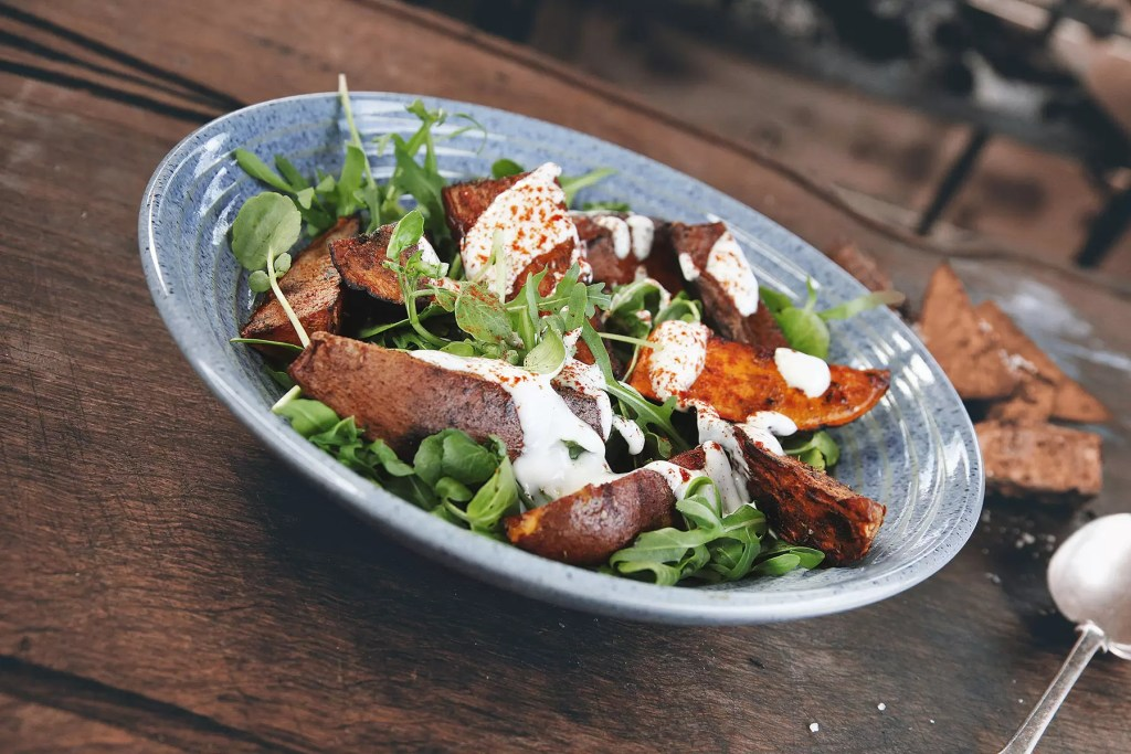 Sweet Potato with watercress and lemon tahini dressing from Charred Genevieve Taylor