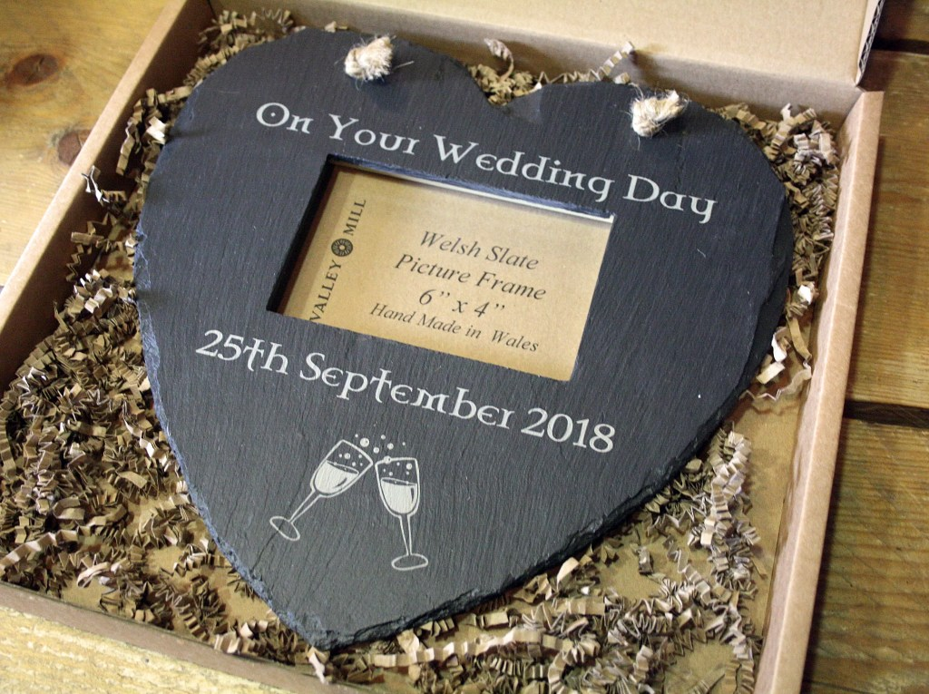 A beautiful Welsh slate personalised heart shaped hanging photo frame makes a fab gift.