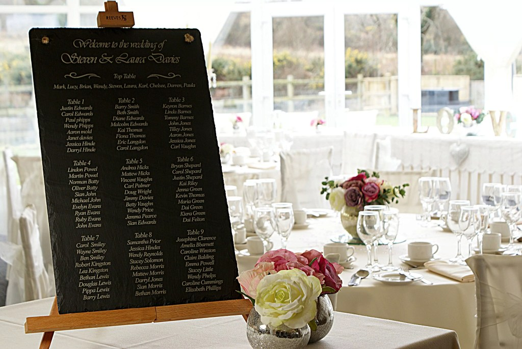 A beautiful Welsh slate table planner greets the guests at the venue