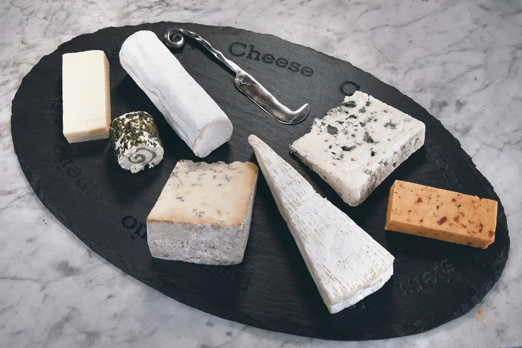 Welsh slate cheeseboard adorned with a stunnning selection of cheeses